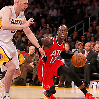 03 November 2013: Atlanta Hawks point guard Dennis Schroder (17) drives past Los Angeles Lakers center Chris Kaman (9) during the Los Angeles Lakers 105-103 victory over the Atlanta Hawks at the Staples Center, Los Angeles, California, USA.