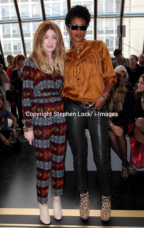 Nicola Roberts and Kelis at the Topshop  Unique show at London Fashion Week, Sunday 18th September 2011 Photo by: Stephen Lock/i-Images
