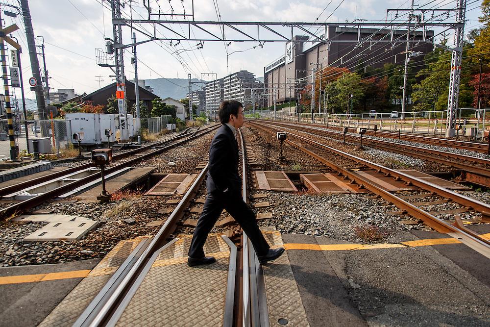 Citizens walk near the Yamazaki Distillery in Yamazaki, Osaka Prefecture, Japan, November 6, 2015. Gary He/DRAMBOX MEDIA LIBRARY