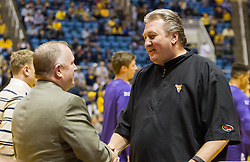 Jan 7, 2017; Morgantown, WV, USA; West Virginia Mountaineers head coach Bob Huggins shakes hands with TCU Horned Frogs coaches prior to their game at WVU Coliseum. Mandatory Credit: Ben Queen-USA TODAY Sports