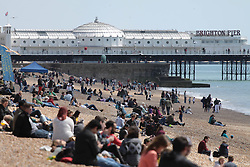 © Licensed to London News Pictures. 03/05/2014. Brighton, UK. hundreds of people are relaxing on Brighton beach while enjoying the sunshine. thousands of people are expected to come to Brighton for the May bank holiday weekend. Photo credit : Hugo Michiels