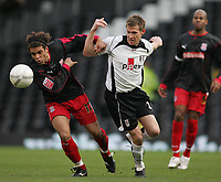 Photo: Lee Earle.<br /> Fulham v Stoke City. The FA Cup. 27/01/2007.Stoke's Darel Russell (L) battles with Brian McBride.