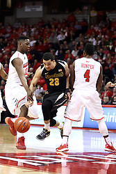 14 February 2015:   Fred VanVleet negotiates the opening between John Jones and Bobby Hunter during an NCAA MVC (Missouri Valley Conference) men's basketball game between the Wichita State Shockers and the Illinois State Redbirds at Redbird Arena in Normal Illinois