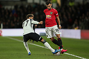 Manchester United midfielder Bruno Fernandes is tackled by Derby County defender Jayden Bogle during the The FA Cup match between Derby County and Manchester United at the Pride Park, Derby, England on 5 March 2020.