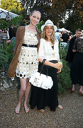 Left to right, JADE PARFITT and BAY GARNETT at a party to celebrate Stephen Jones's 25 Years of Millinery held at Debenham House, 8 Addison Road, London W14 on 13th July 2006.<br />