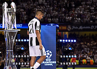Paulo Dybala of Juventus is dejected and walk by the Champions League Trophy during the UEFA Champions League Final match between Real Madrid and Juventus at the National Stadium of Wales, Cardiff, Wales on 3 June 2017. Photo by Giuseppe Maffia.<br /> <br /> Giuseppe Maffia/UK Sports Pics Ltd/Alterphotos