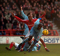Photo: Jed Wee.<br />Nottingham Forest v Chesterfield. Coca Cola League 1.<br />31/12/2005.<br />Chesterfield's Reuben Hazell tries to get to the loose ball as players appeal for a foul behind him.