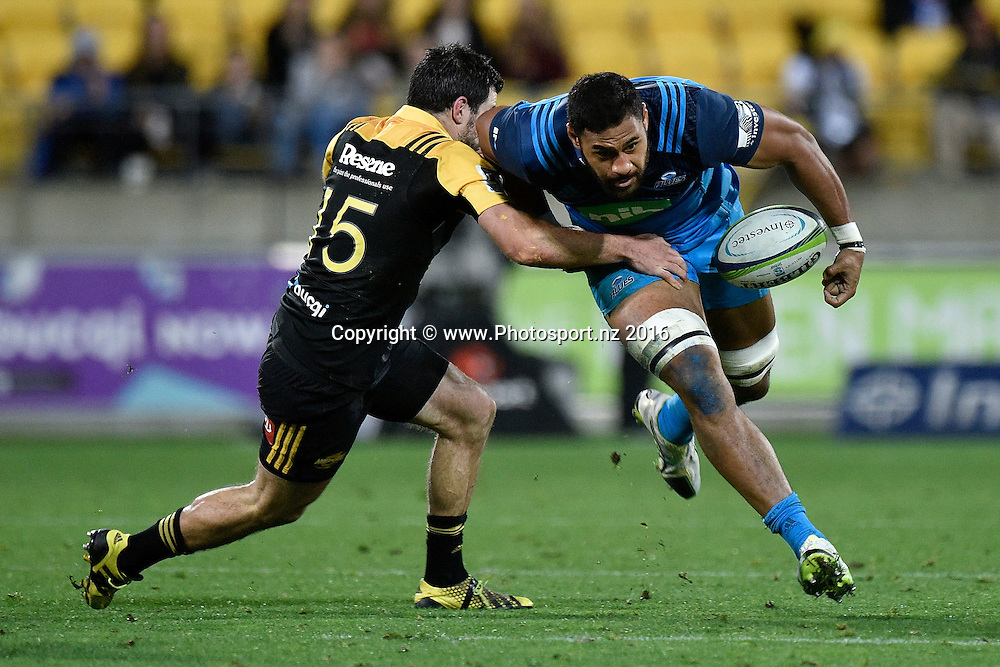 Blues' Patrick Tuipulotu (R is tackled by Hurricanes' Michael Fatialofa during the Hurricanes vs Blues Super Rugby  match at the Westpac Stadium in Wellington on Saturday the 2nd of July 2016. Copyright Photo by Marty Melville / www.Photosport.nz