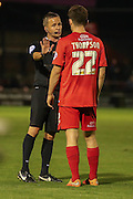 York City forward Reece Thompson gets a lecture from the referee  during the Sky Bet League 2 match between York City and Oxford United at Bootham Crescent, York, England on 29 September 2015. Photo by Simon Davies.