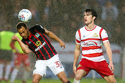 Elliott Bennett of Blackburn Rovers beats John Marquis of Doncaster Rovers to the ball - Mandatory by-line: Robbie Stephenson/JMP - 24/04/2018 - FOOTBALL - The Keepmoat Stadium - Doncaster, England - Doncaster Rovers v Blackburn Rovers - Sky Bet League One