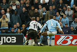 MANCHESTER, ENGLAND - Saturday, March 27, 2004: Manchester City's Sylvain Distin tackles Fulham's Luis Boa Morte in the penalty area during the Premiership match at the City of Manchester Stadium. (Pic by David Rawcliffe/Propaganda)