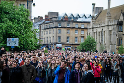 © Licensed to London News Pictures. 01/05/2017. Oxford, UK. Oxford University students and members listen to a service being read from the roof of Magdalen Chapel during celebrations for May Day in the early hours of the morning. Students were again prevented from jumping from the bridge in tot he water, which has historically been a tradition, due to injuries at a previous years event . Photo credit: Ben Cawthra/LNP