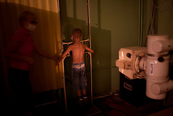 A young boy gets an X-Ray at the TB Hospital in Balti.