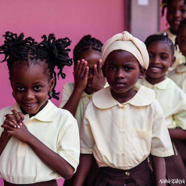 Ms. Arlene Smith, walks her 1st grade class to their classroom.  First Day of School at Joseph A. Gomez Elementary School. 4 September 2012.  © Aisha-Zakiya Boyd