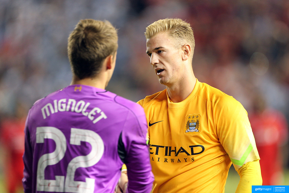 Goalkeepers Joe Hart, right), Manchester City and Simon Mignolet, Liverpool, after the Manchester City Vs Liverpool FC Guinness International Champions Cup match at Yankee Stadium, The Bronx, New York, USA. 30th July 2014. Photo Tim Clayton
