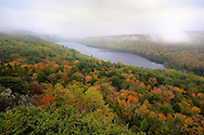 Morning fog rolls through the valley and over Lake of the Clouds.<br />