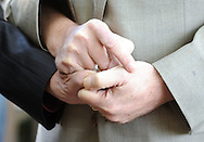 Herb Millman (left), and his partner John Dwyer of New Hope, Pennsylvania hold hands as they participate in a mass commitment ceremony to married couples and those in committed relationships Saturday October 17, 2015 at Ferry Street Park in New Hope, Pennsylvania.  (Photo by William Thomas Cain)