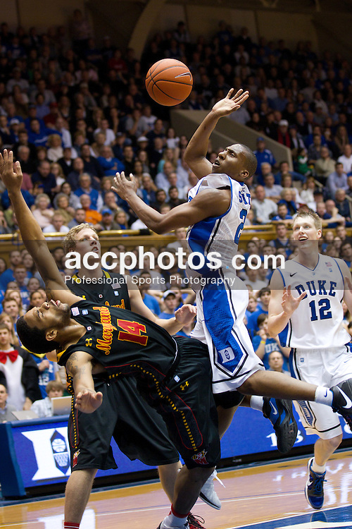 DURHAM, NC - JANUARY 09: Nolan Smith #2 of the Duke Blue Devils looses control of the ball while shooting over Sean Mosley #14 of the Maryland Terrapins on January 09, 2011 at Cameron Indoor Stadium in Durham, North Carolina. Duke won 71-64. (Photo by Peyton Williams/Getty Images) *** Local Caption *** Nolan Smith;Sean Mosley