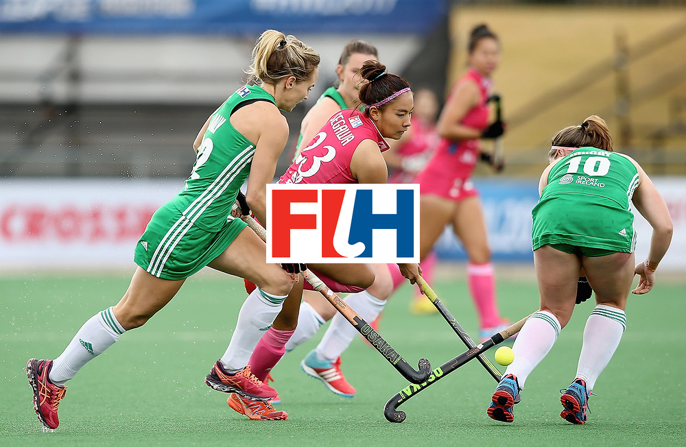 JOHANNESBURG, SOUTH AFRICA - JULY 08:  Maho Segawa of Japan takes on the Ireland defence during the pool A match between Japan and Ireland on day one of the FIH Hockey World League Semi-Final at Wits University on July 8, 2017 in Johannesburg, South Africa.  (Photo by Jan Kruger/Getty Images for FIH)