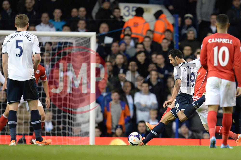 Tottenham's Mousa Dembele takes a shot at goal - Photo mandatory by-line: Mitchell Gunn/JMP - Tel: Mobile: 07966 386802 02/03/2014 - SPORT - FOOTBALL - White Hart Lane - London - Tottenham Hotspur v Cardiff City - Premier League