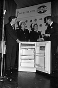 26/03/1963<br /> 03/26/1963<br /> 26 March 1963<br /> Prize draw at frozen food seminar for Housewives sponsored by M and P Hanlon Ltd. and Birds-Eye foods Ltd. was held at the Gresham Hotel, Dublin. During the seminar a draw was held for a refrigerator. Picture Shows: Mr F.J. Hardy, Managing Director of M and P Hanlon Ltd. congratulating the winner, Mrs. K. Quigley, Vice-President Skerries I.C.A. Guild. Also in the image are Mrs K. Hogan, President, Dublin Federation I.C.A. who drew the winning ticket and Mr. P.J. Hendrick, Sales Manager M and P Hanlon Ltd.
