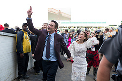 University of Louisville head coach Rick Pitino, friends with the owner of the owners of Always Dreaming, signals the crowd after Always Dreaming trained by Todd Pletcher wins the 143rd running of the Kentucky Derby at Churchill Downs May 6, 2017.