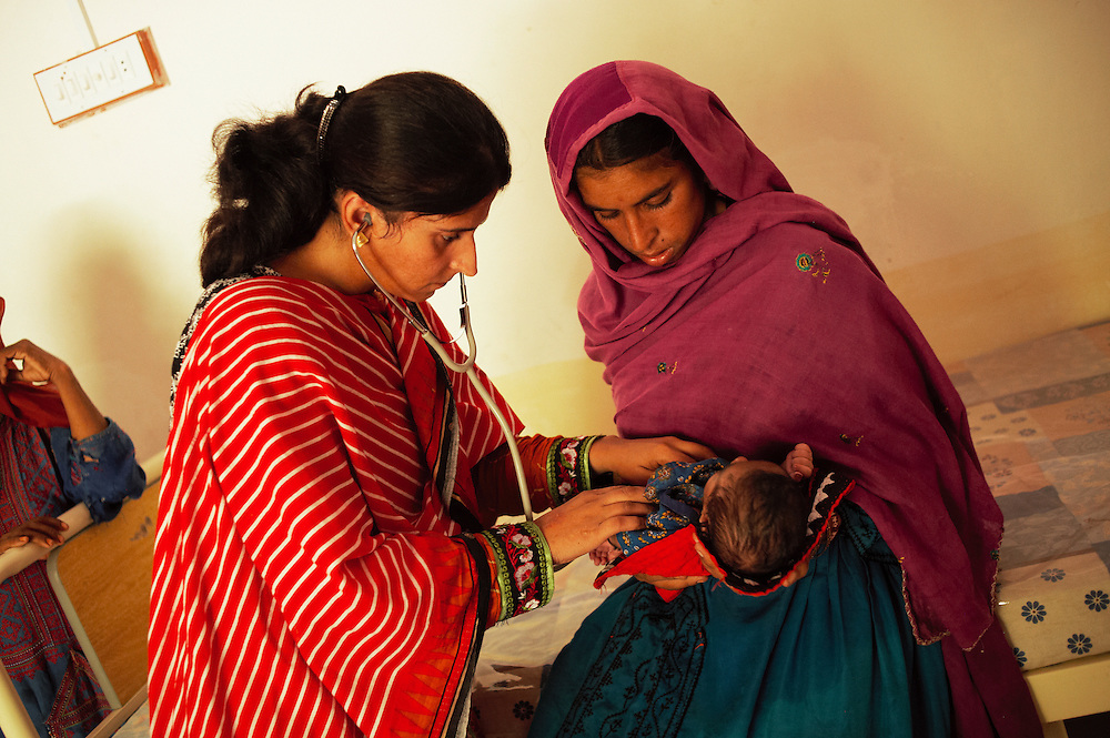 Doctor Salma Mumtaz checks up on Mavi Qasim and baby Arbee Qasim, 15 days old who was delivered at the Bhu Khero government health clinic, Dadu, Sindh, Pakistan on July 5, 2011.