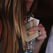 Musician's tip jar at Legends Corner in Nashville, also known as Music City, U.S.A., is most famous for its status as the long-time capital of country music, home to the Grand Ole Opry and the Country Music Hall of Fame. Photography by Jose More