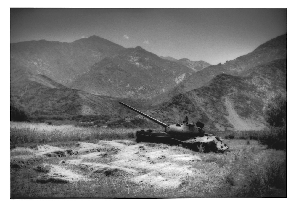 Abandoned Russian tank in a wheat field in the Panjshir Valley, the former bastion of Ahmed Massoud and the Northern Alliance, Afghanistan.