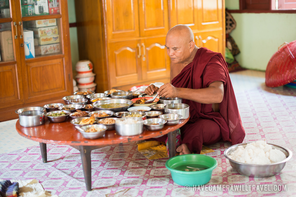 A monk eating a midday meal at a monastery in Bagan, Myanmar (Burma).
