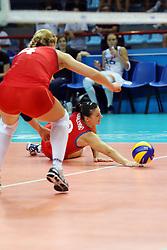 Azerbaijan Kseniya Kovalenko digs a ball