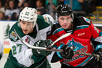 KELOWNA, BC - SEPTEMBER 28:  Jalen Price #27 of the Everett Silvertips checks Jake Poole #23 of the Kelowna Rockets after the puck drop at Prospera Place on September 28, 2019 in Kelowna, Canada. (Photo by Marissa Baecker/Shoot the Breeze)