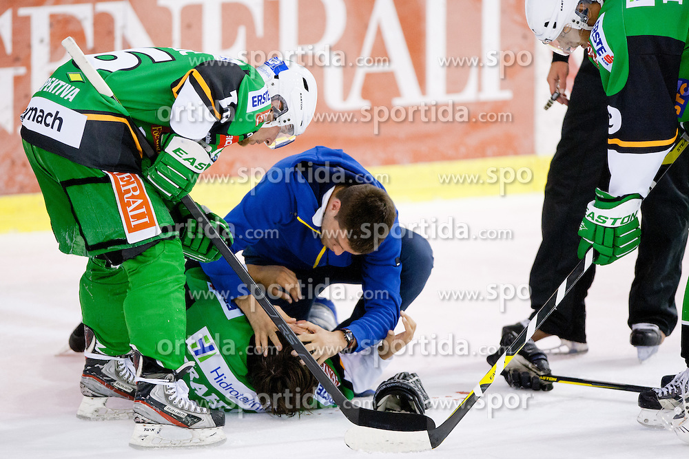 Ziga Grahut lying on the ice injured during friendly ice hockey match between HDD Telemach Olimpija and Stavanger Oilers (NOR) , on August 14, 2012 in Hala Tivoli, Ljubljana, Slovenia. (Photo by Matic Klansek Velej / Sportida.com)