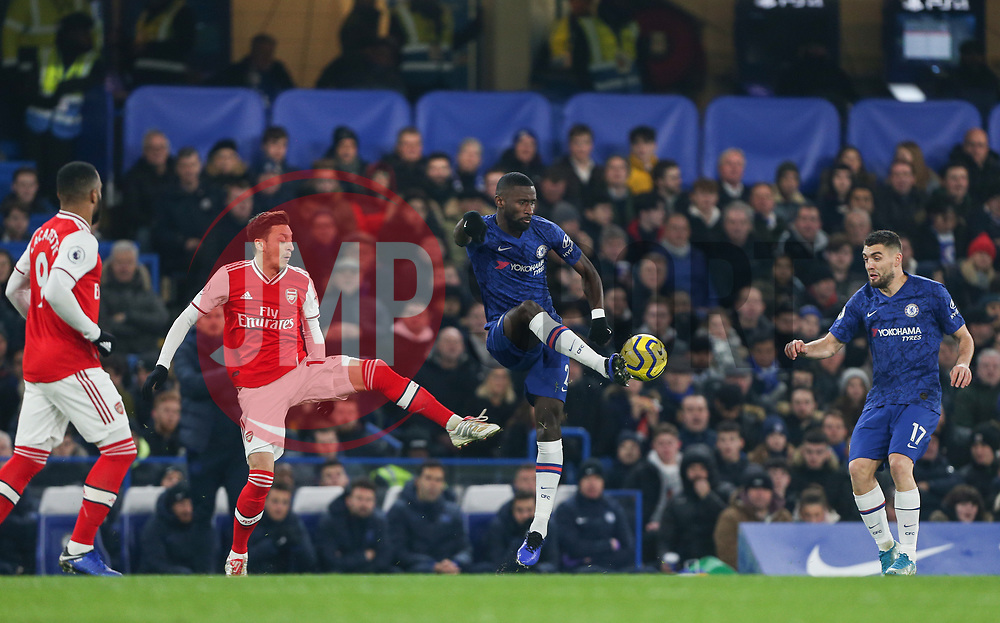Antonio Rudiger of Chelsea gets to the ball ahead of Mesut Ozil of Arsenal - Mandatory by-line: Arron Gent/JMP - 21/01/2020 - FOOTBALL - Stamford Bridge - London, England - Chelsea v Arsenal - Premier League