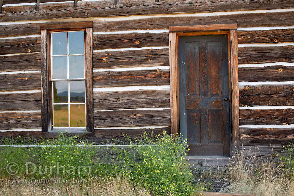 Publicly owned and managed, the Whitcomb-Cole hewn log house is an example of early pioneer homes built in the 1890's.  It is one of only a few pioneer log homes still standing in Klickitat County, Washington. It originally stood two miles across Conboy lake on land first settled by Stephen Whitcomb. In 1891, John Cole acquired the land from Whitcomb and built the main structure of the house, which included a large downstairs room that served as a kitchen, dining, sitting and family room. The house is located in Conboy Lake National Wildlife Refuge, Washington.