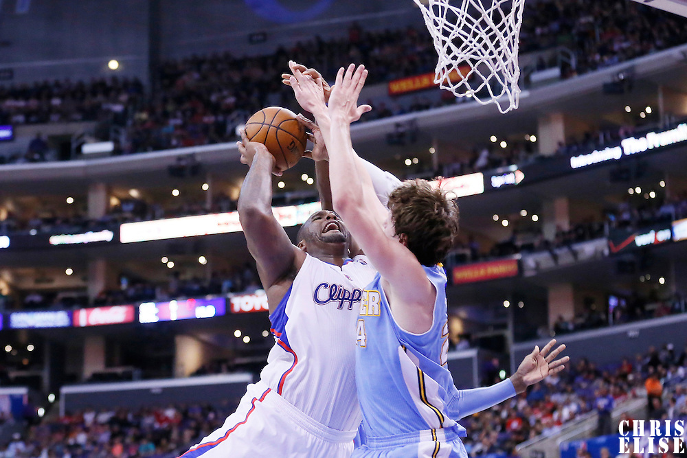 15 April 2014: Los Angeles Clippers forward Glen Davis (0) goes to the hoop against Denver Nuggets forward Jan Vesely (24) during the Los Angeles Clippers 117-105 victory over the Denver Nuggets at the Staples Center, Los Angeles, California, USA.