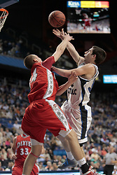 Dixie Heights' Parker Stansberry, left, contests a shot by Lexington Catholic's Scott Schuette in the first half. Lexington Catholic hosted Dixie Heights in the 2011 PNC/ KHSAA Boys Sweet 16, Wednesday, March 16, 2011.