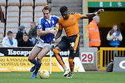Wolverhampton Wanderers defender Kortney Hause  and Ipswich Town striker Brett Pitman battle for the ball during the Sky Bet Championship match between Wolverhampton Wanderers and Ipswich Town at Molineux, Wolverhampton, England on 2 April 2016. Photo by Alan Franklin.