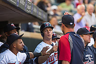 Justin Morneau #33 of the Minnesota Twins is congratulated in the dugout after scoring against the Philadelphia Phillies on June 11, 2013 at Target Field in Minneapolis, Minnesota.  The Twins defeated the Phillies 3 to 2.  Photo: Ben Krause