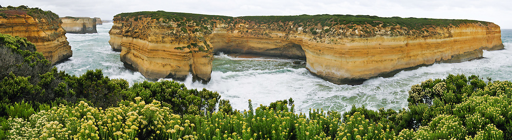 At Twelve Apostles Marine National Park, the Indian Ocean (or Southern Ocean according to Australian geographers) pounds and erodes soft miocene limestone bluffs of Port Campbell National Park, along the Great Ocean Road, Victoria, Australia. The Great Ocean Road (B100) is a 243-km highway along the southeast coast of Australia between Torquay and Warrnambool, in the state of Victoria. Dedicated to casualties of World War I, the Great Ocean Road was built by returned soldiers between 1919 and 1932 and is the world's largest war memorial. Panorama stitched from 5 overlapping images.