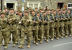 © Licensed to London News Pictures. 16/03/2012.  Warminster, Wiltshire, UK.  Farewell parade for 3rd Battalion, The Yorkshire Regiment. The soldiers, who are departing for a nine-month tour in Afghanistan, marched through the town before attending a service in the Minster Church. The parade comes just 10 days since six of their comrades were killed in Afghanistan...Photo credit : Simon Chapman/LNP