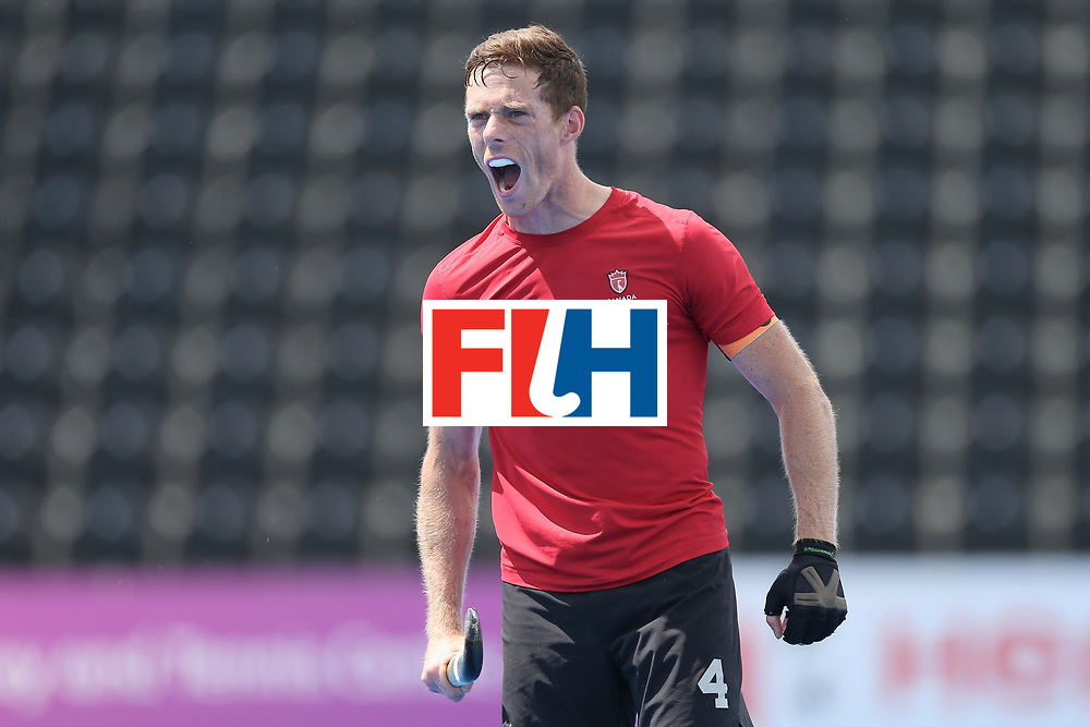 LONDON, ENGLAND - JUNE 25: Tupper Scott of Canada celebrates after the 5th/6th place match between India and Canada on day nine of the Hero Hockey World League Semi-Final at Lee Valley Hockey and Tennis Centre on June 25, 2017 in London, England. (Photo by Alex Morton/Getty Images)