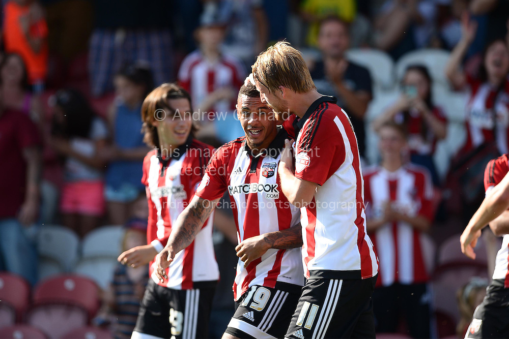 Andre Gray of Brentford celebrates with Philipp Hofmann of Brentford as James Tarkowski of Brentford scores his sides second goal of the game to make it 2-2. Skybet football league Championship match, Brentford v Ipswich Town at Griffin Park in London on Saturday 8th August 2015.<br /> pic by John Patrick Fletcher, Andrew Orchard sports photography.