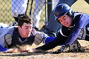 MANORVILLE, NY - MARCH 30, 2009: Hauppauge at Eastport-South Manor boys High School baseball. Hauppague catcher, Matt Reistetter tags out Eastport- South Manor's #4-Ryan McCormick trying to score on Mike Annunziata's double in the 4th inning during Hauppauge's 6-2 win over Eastport-South Manor. Photo by Kathy Kmonicek