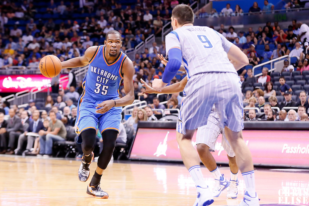 30 October 2015: Oklahoma City Thunder forward Kevin Durant (35) dribbles during the Oklahoma City Thunder 139-136 double overtime victory over the Orlando Magic, at the Amway Center, in Orlando, Florida, USA.