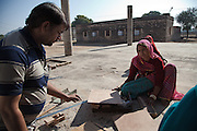 People from Rajasthan villages making wood boxes, in Barefoot College old campus. These rural artisans produce clothing and accessories, decorative home furnishings, furniture, rugs, textiles, handmade paper products, puppets, educational toys, metalwork, and leather goods. 01/2013 © Marida Augusto/Max Hirzel