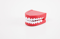 Artificial dentures over white background