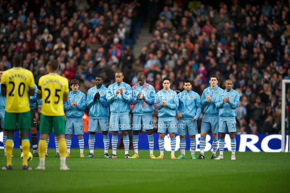 MANCHESTER, ENGLAND - Saturday, December 3, 2011: Manchester City players stand for a minute's applause in memory of Gary Speed, who died earlier in the week, during the Premiership match against Norwich City at City of Manchester Stadium. (Pic by David Rawcliffe/Propaganda)