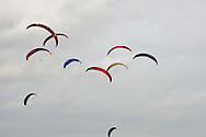 The kites of competitors taking part in one of the races at the European Kite Buggy Championships at Hoylake, Wirral, north west England. Around 75 buggies, with both male and female pilots, from 10 countries took part in the annual event which lasted from 5-9 September 2011. The three-wheeled, single-seated, steel frame buggy was powered  by a traction, or power kite and could achieve speeds of up to 70mph/110km/h.