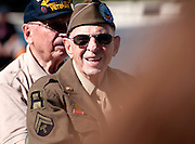 Veterans of the Battle of the Bulge march in the Veterans Day Parade, which honors American military veterans, in Tucson, Arizona, USA.